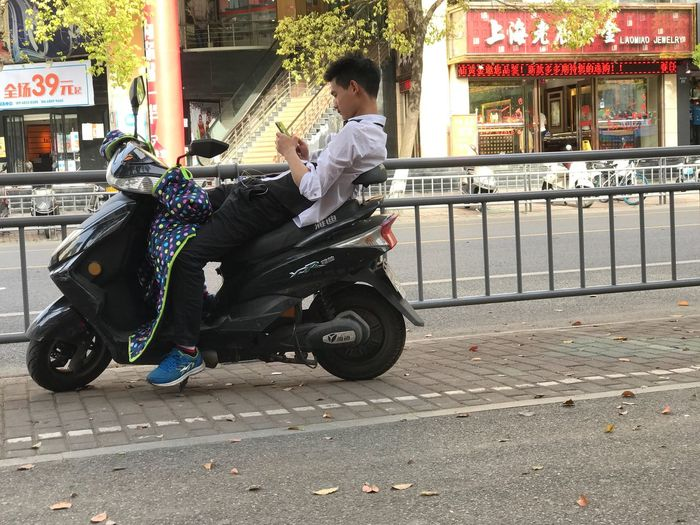 Jiaxing, Zhejiang, China, April 2017. Transportation Street Outdoors Casual Clothing One Person Day Real People Travel Road City Young Adult