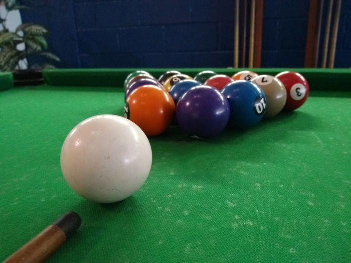 Multi colored balls on table