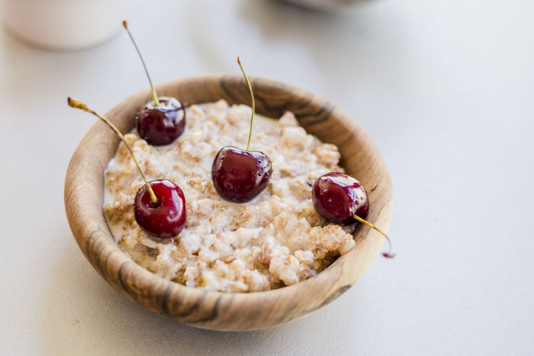 Close-up of breakfast in wooden bowl on table