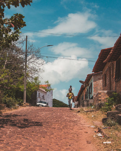 Exploring the ghost town of Alcantara. Architecture Boy Building Exterior Built Structure Childhood Cloud - Sky Day Discover Your City Explore Father House Man Nature Outdoors People Real People Road Sky Standing Street Streetphotography Travel Traveling Travelling Tree The Photojournalist - 2017 EyeEm Awards The Portraitist - 2017 EyeEm Awards The Street Photographer - 2017 EyeEm Awards EyeEmNewHere EyeEm Selects This Is Latin America Adventures In The City The Street Photographer - 2018 EyeEm Awards A New Beginning Human Connection
