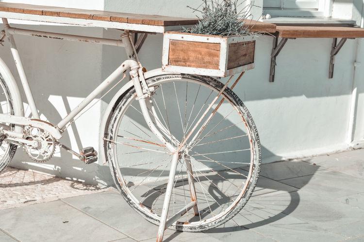 Bicycle wheel by wall