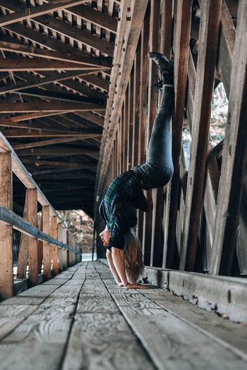 Woman exercising on footbridge