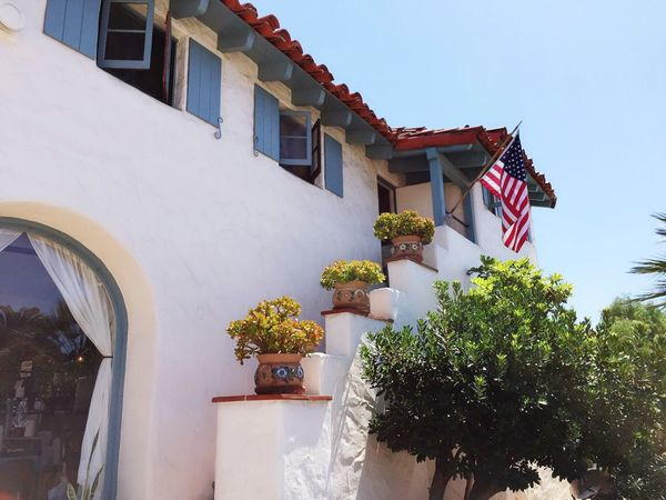 EyEmNewHere Architecture Patriotism Building Exterior Built Structure Flag No People Outdoors Day Low Angle View Tree Stars And Stripes Sky SD America American Flag EyeEmNewHere