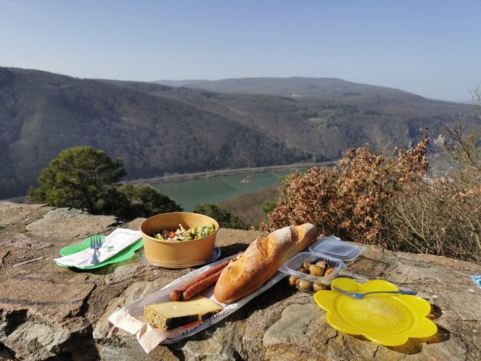 High angle view of breakfast on table against mountains