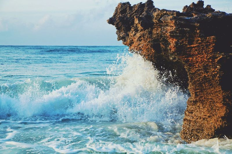 View of waves in sea against sky