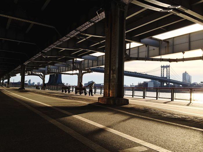 Manhattan bridge seen from road in city