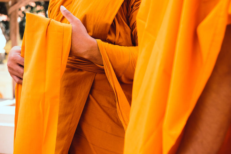 Yellow robe of Buddhist monks, Closeup on buddhist monk Buddhist Buddhist Temple In Thailand Religion And Tradition Religious Art Buddhist Culture Buddhist Monks Buddhist Temple Close-up Clothing Human Body Part Lifestyles Midsection Monk  Monks Orange Orange Color Real People Religion Religion And Beliefs Religious  Robe Textile Yellow Yellow Robe