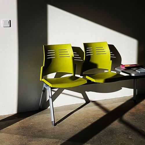 Chair No People Indoors  Yellow Home Interior Architecture Modern Textured  Color Architecture Colors Minimalism Mobile Minimalist Mobilephotography Mobile Editing Square Geometric Abstraction Illuminated Vibrant Color City Geometry Shadows Sunlight