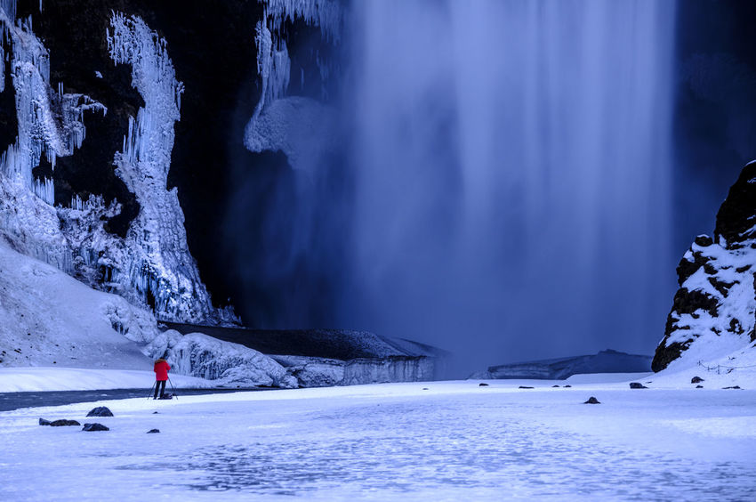 EyeEmNewHere Adult Adventure Beauty In Nature Cold Temperature Extreme Sports Frozen Ice Landscape Long Exposure Mountain Nature One Person Outdoors People Red Jacket Scenics Skogar Skogarfoss Snow Sport Travel Destinations Waterfall Weather Winter Go Higher