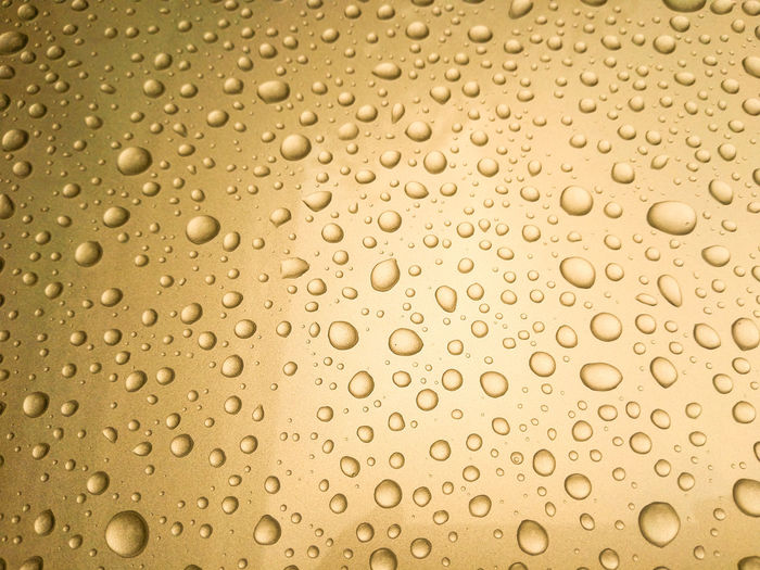 Full frame shot of wet glass