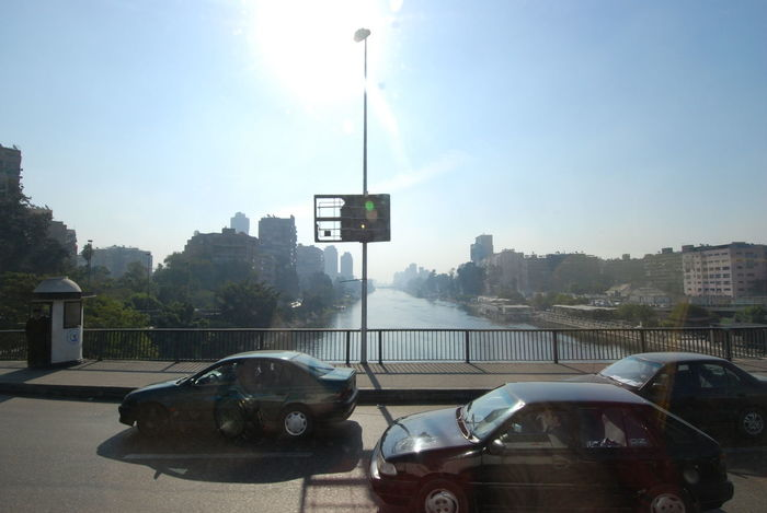 High Noon over the Nile Architecture Car City Crossing The Nile Day High Noon Land Vehicle Mode Of Transport Nile River No People Outdoors Sky Transportation