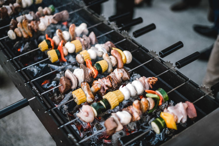 High angle view of meat on barbecue grill