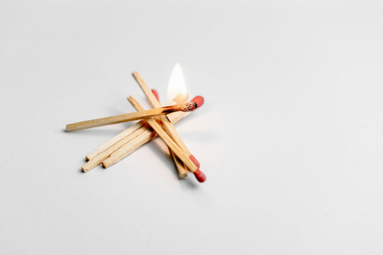 High angle view of pencils on table against white background