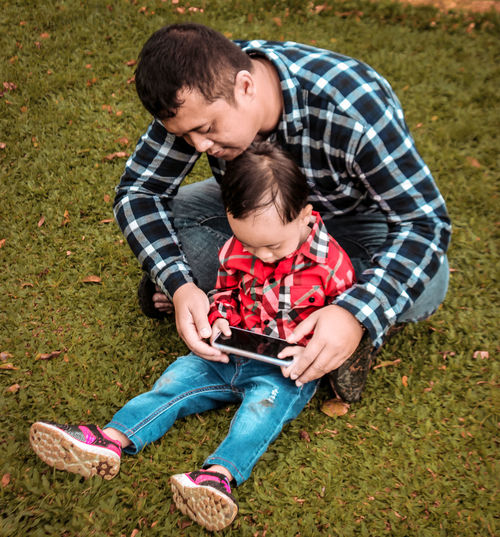 Father and son baby on grass