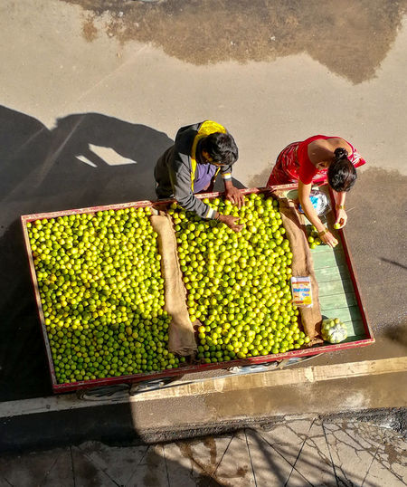 People working at market stall