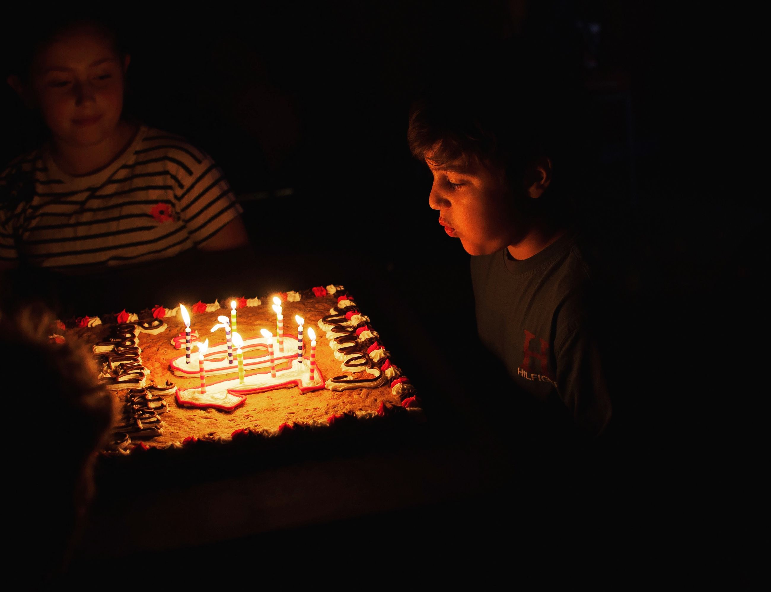 candle, flame, burning, birthday candles, boys, birthday cake, childhood, indoors, night, real people, celebration, heat - temperature, togetherness, food and drink, illuminated, two people, casual clothing, son, food, lifestyles, birthday, sweet food, freshness, people