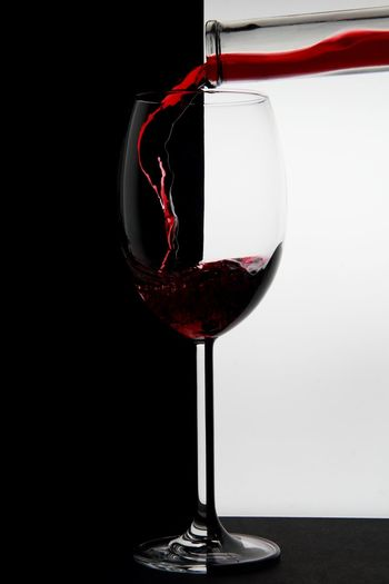 black and white and red ;o) Wineglass Refreshment Wine Glass Drink Food And Drink Red Wine Studio Shot Glass - Material No People Wine Bottle Black Background Luxury Crystal Glassware Red Highspeed Photography EyeEm Gallery EyeEm Best Shots Bottle Drinking Glass Still Life Black And White Absract Art Liquid Art Details My Best Photo
