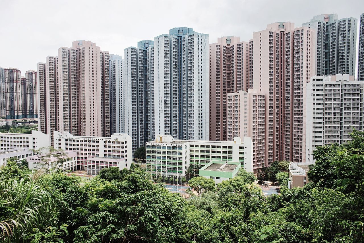 High angle view of residential skyscrapers against blue sky