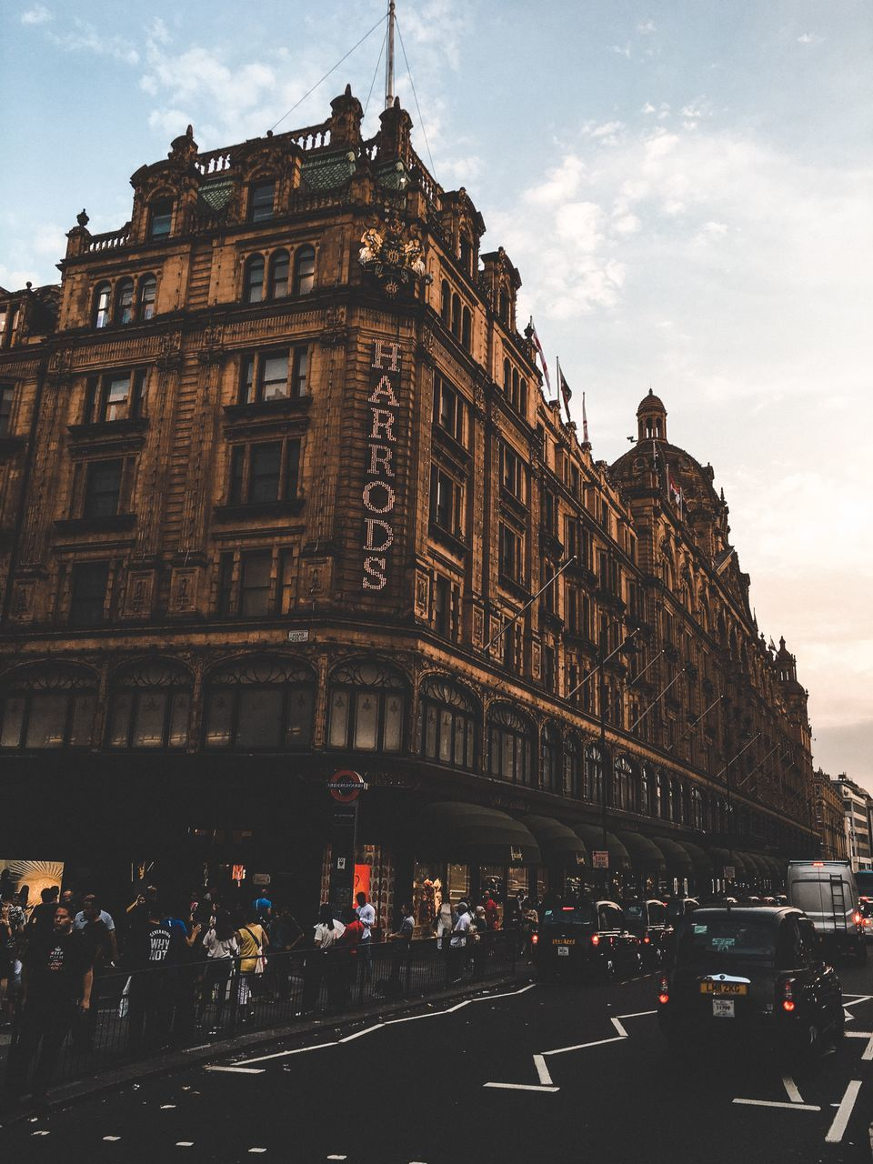 building exterior, architecture, large group of people, sky, built structure, street, real people, outdoors, day, road, cloud - sky, men, city, people