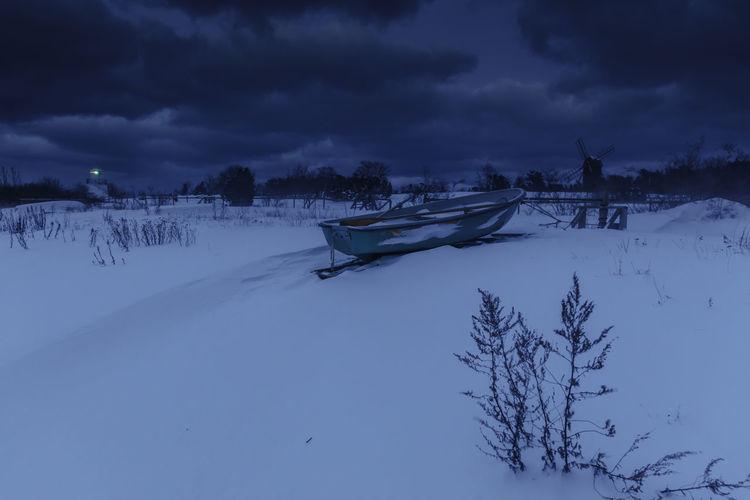 Calm Dark Sky Lighthouse Sweden Windmill Winter Blue Boat Byxelkrok Cold Temperature No People Snow Öland