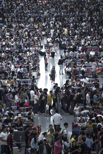 Crowd waiting at railroad station