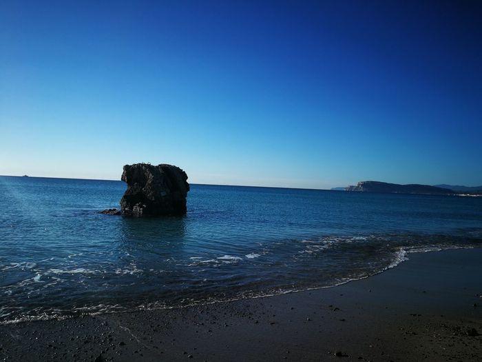 EyeEm Gallery EyeEm Selects Ancient Tower Sardinia Sardegna Italy  Sardinia Sardegna Water Clear Sky Sea Beach Blue Sky Horizon Over Water Rocky Coastline Rock Formation Rushing Coastline Coast Wave Crashing Rock Cliff