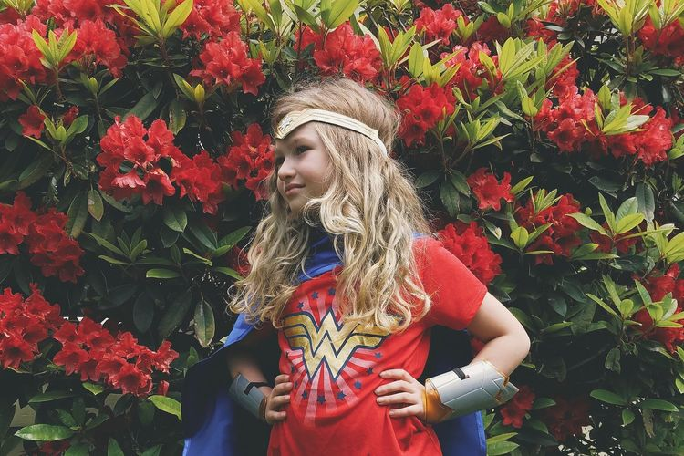 Front View Red Day Outdoors One Young Woman Only Close-up Child Girl Rhododendron Flowers Childhood Wonder Woman Superhero Curls Curly Hair Girl Power