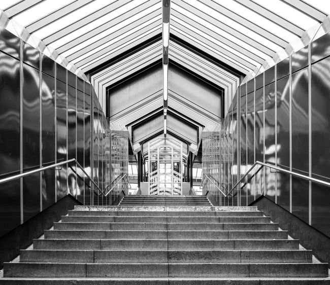 Architecture Architecture B&w Best Of Stairways Black And White Built Structure Day Geometric Shape Indoors  Low Angle View Modern No People No People, Railing Railing Reflection S-bahnhof Stairs Stairs_collection Stairway Steps Subway Station Symmetry