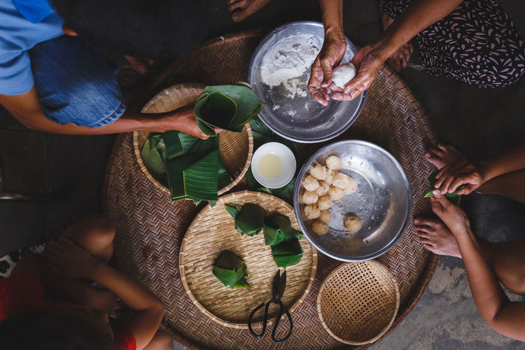 High Angle View Of People Preparing Rice Cake