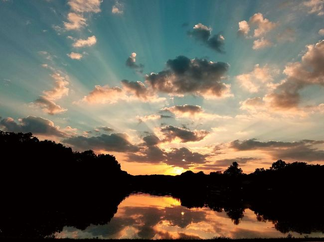 Just another Iowa sunset!!😍 Check This Out River Riverbank Driving Around Tree Sunset Water Silhouette Reflection Dramatic Sky Sky Landscape Cloud - Sky