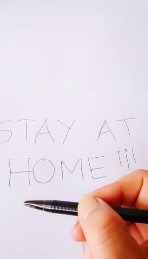 Cropped hand writing text on paper