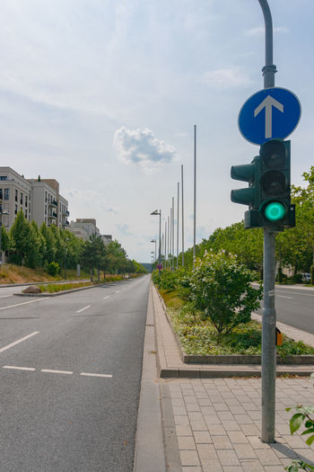 Road by city against sky