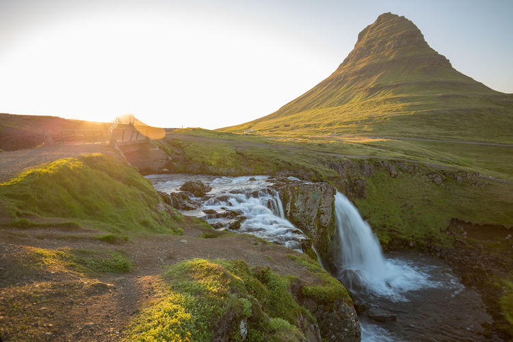 Beauty In Nature Day Environment Flowing Flowing Water Idyllic Land Landscape Lens Flare Motion Mountain Nature No People Non-urban Scene Plant Scenics - Nature Sky Tranquil Scene Tranquility Water Waterfall