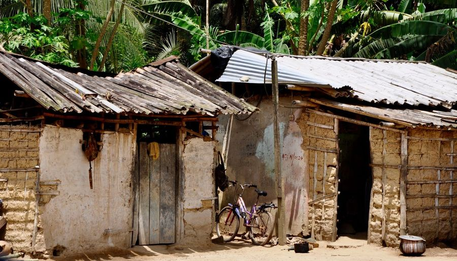 Ghana Poor  Rural Abandoned Africa Building Building Exterior Built Structure Bycicle Corrugated Metal Developing Country Dwelling House Huts Leisure Activity Mud Hut Outdoors People Poverty Residential District Roof Rural Scene Social Issue Traditional Wood - Material