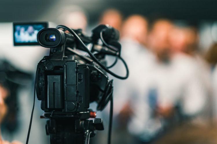 Camera at media conference