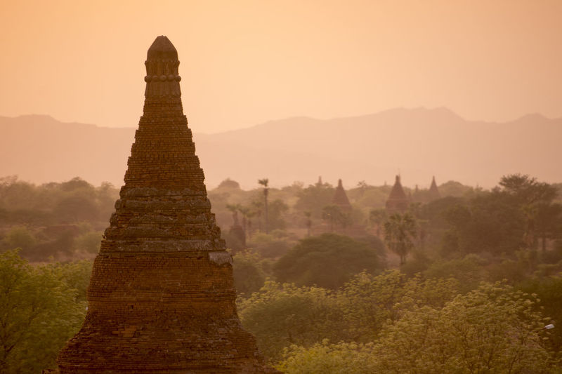 Stupa against clear sky during sunset
