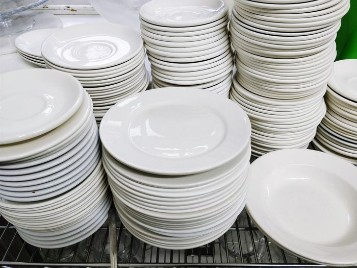 Stack of plates on table in kitchen