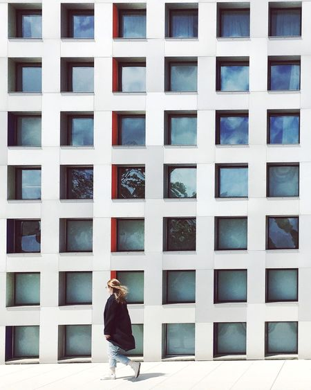 EyeEm Selects Architecture Steven Holl MIT Campus One Person Window Building Exterior Real People Built Structure Modern Lifestyles Women Day Young Adult Full Length Outdoors Young Women City Adult People Adults Only Clarity Order Grid Walking Around