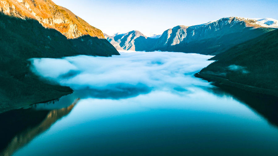 Fog progress Drone  Aerial View Fjord Water Mountain Snow Cold Temperature Winter Glacier Lake Reflection Sky Mountain Range Polar Climate