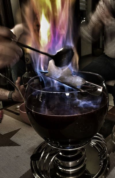 Feuerzangenbowle Christmas Time Real People One Person Indoors  Preparation  Making Heat - Temperature Holding Close-up Stove