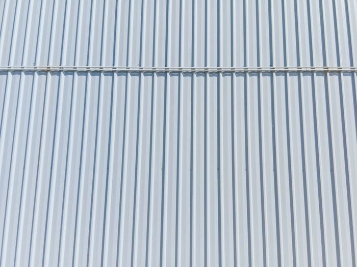 Full frame shot of patterned wall.the steel wall of the building texture background.
