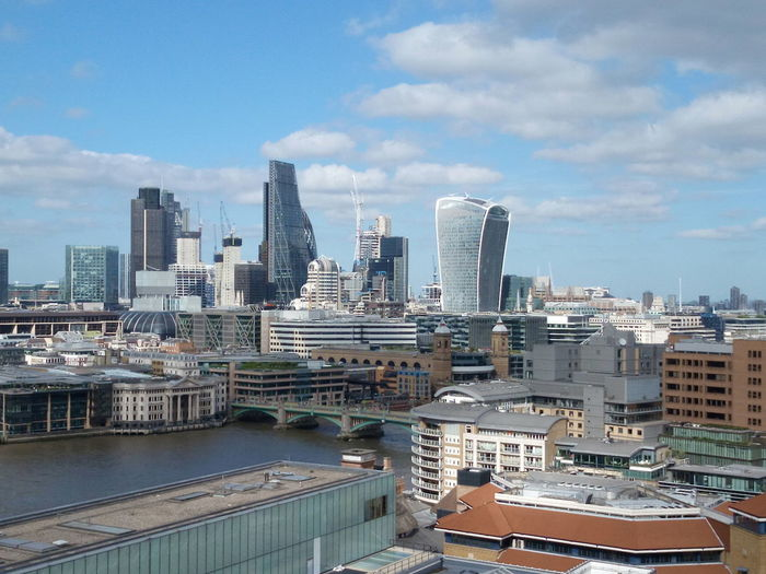 City skyline from Tate Modern City Of London Gerkin  Skyline Southwark Bridge Tate Modern Gallery Thames Walkie Talkie Building Architecture Building Building Exterior Cheesegrater Building Cityscape Cloud - Sky Day Financial District  Modern No People Office Building Exterior Sky Skyscraper Sun Urban Skyline EyeEmNewHere