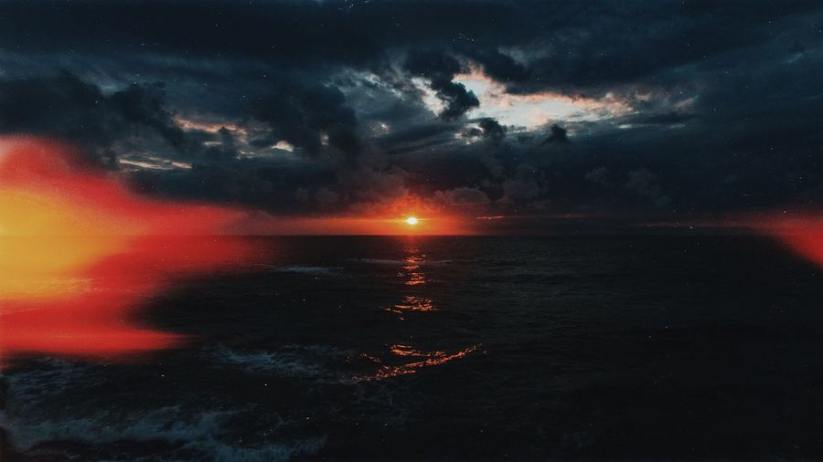 Sunset Sunset Beauty In Nature Sea Scenics Sky Dramatic Sky Cloud - Sky Orange Color Nature No People Tranquility Tranquil Scene Horizon Over Water Outdoors Sun Water Storm Cloud Wave Astronomy Day The Week On EyeEm