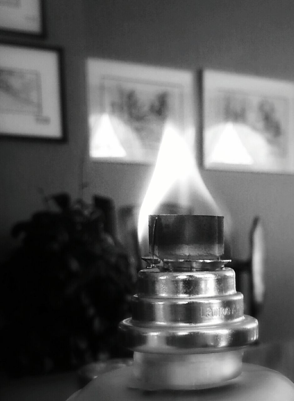Close-Up Of Burning Oil Lamp At Night