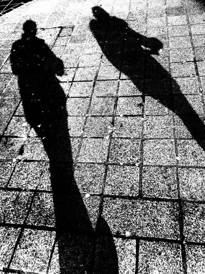 Low section of silhouette man on shadow