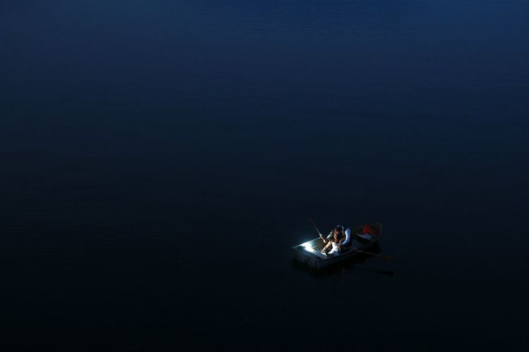 High angle view of people on boat at sea