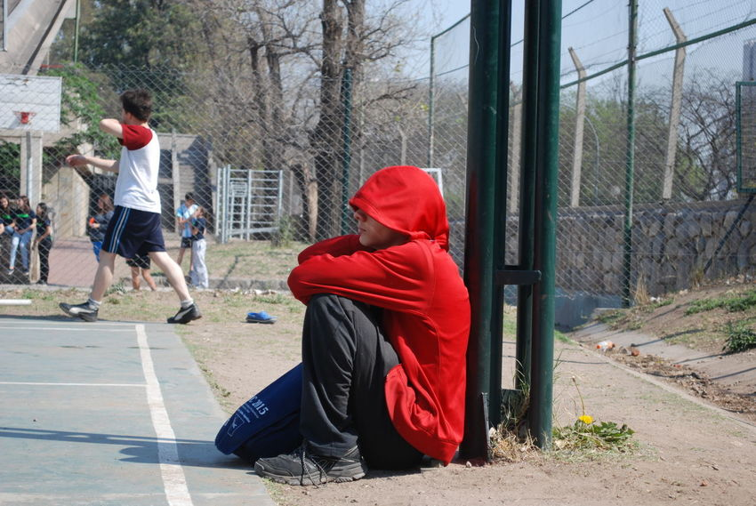Alone Time Boy Day Outdoors Playing Real People Red Color Red Hoodie Whatching