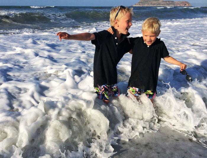 Sibling Enjoying In Sea