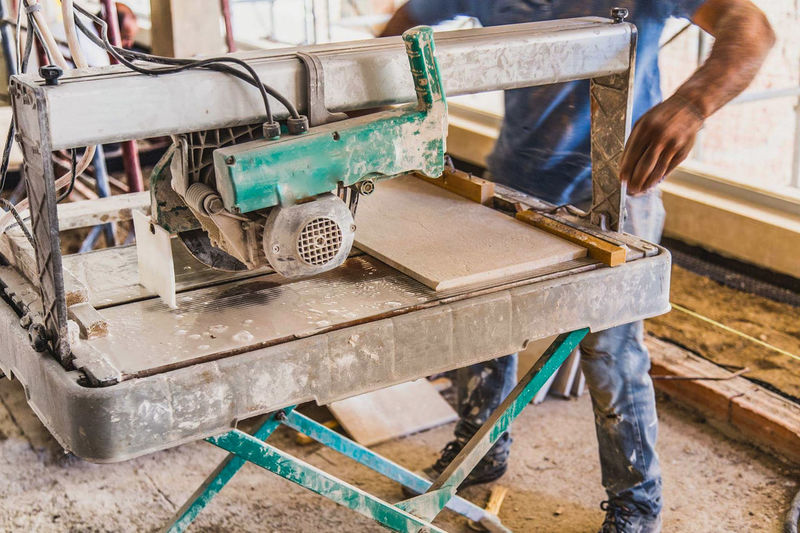 Low section of man working on chair