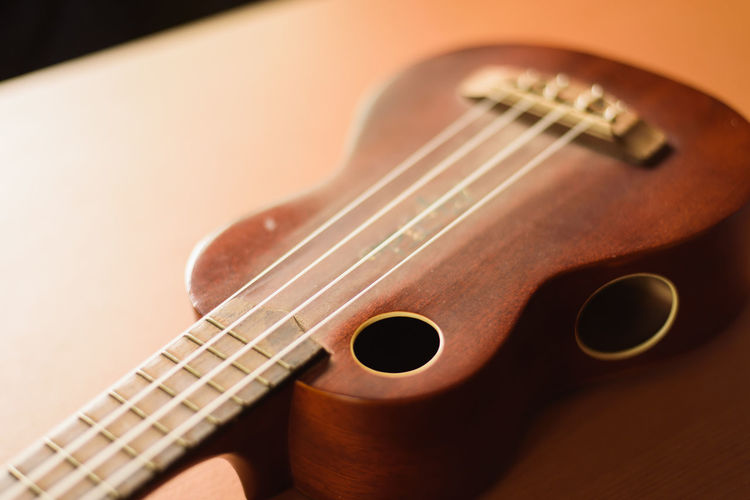 Acoustic Guitar Arts Culture And Entertainment Brown Close-up Colored Background Fretboard Guitar Indoors  Music Musical Equipment Musical Instrument Musical Instrument String No People Selective Focus Single Object String String Instrument Studio Shot Violin Wood - Material